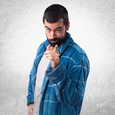 dressing gown: Man in dressing gown pointing to the front