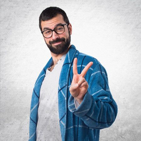 dressing gown: Man in dressing gown doing victory gesture