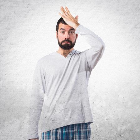doubts: Man in pajamas having doubts