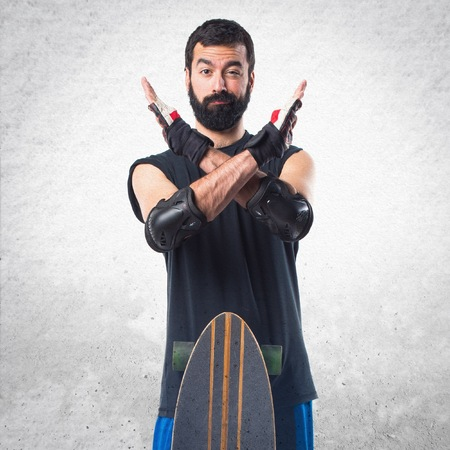 x sport: Skater doing NO gesture Stock Photo