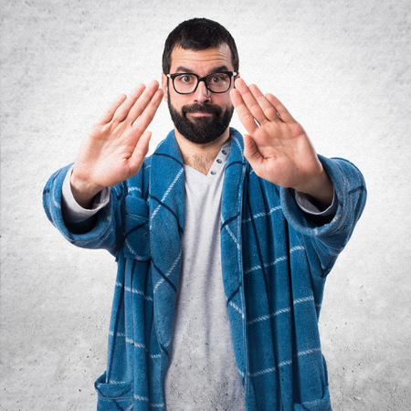 dressing gown: Man in dressing gown making stop sign Stock Photo