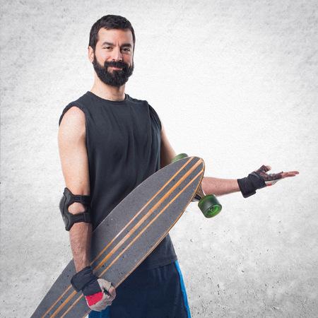skater: Skater presenting something Stock Photo