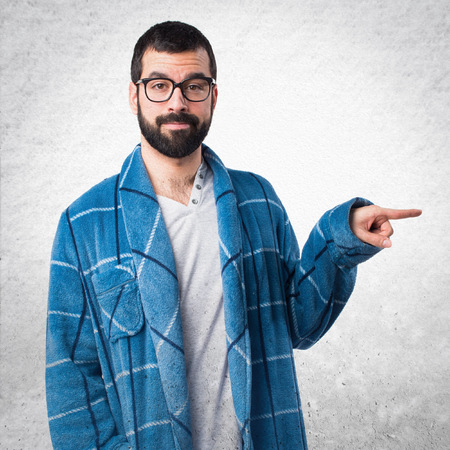 dressing gown: Man in dressing gown pointing to the lateral