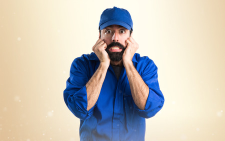 frightened: Frightened plumber Stock Photo