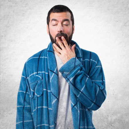 dressing gown: Man in dressing gown yawning