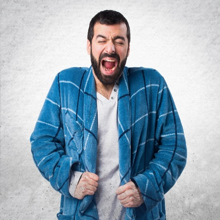 dressing gown: Man in dressing gown shouting Stock Photo