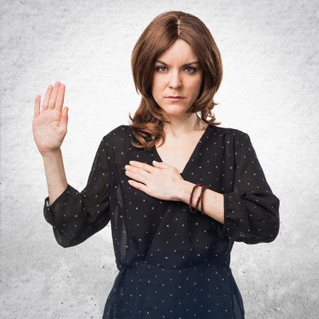 oath: Woman doing oath