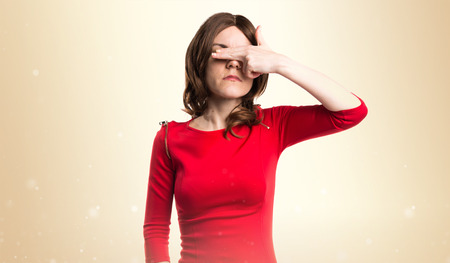 covering: Brunette woman covering her eyes