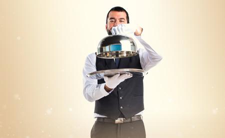 hotel staff: Luxury waiter holding a tray