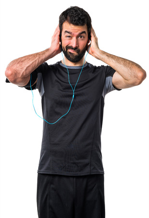 sportman: Sportman covering his ears Stock Photo