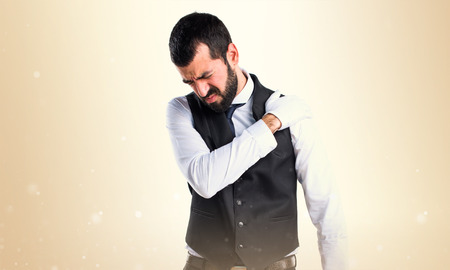 Luxury waiter with shoulder pain Stock Photo