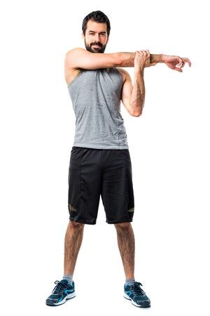 sportman: Sportman stretching arms