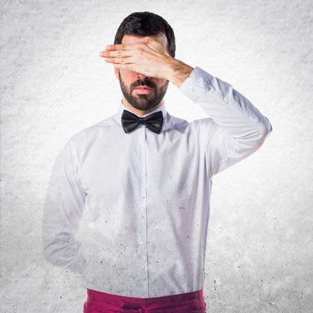 covering: Waiter covering his eyes Stock Photo