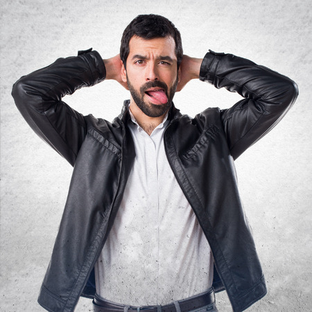 vivacious: Man with leather jacket taking out his tongue