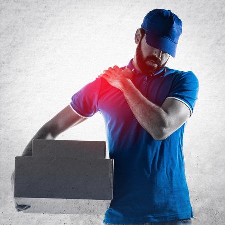 Delivery man with shoulder pain Standard-Bild