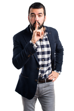 l hand: Handsome man making silence gesture
