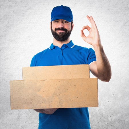 express positivity: Delivery man making OK sign