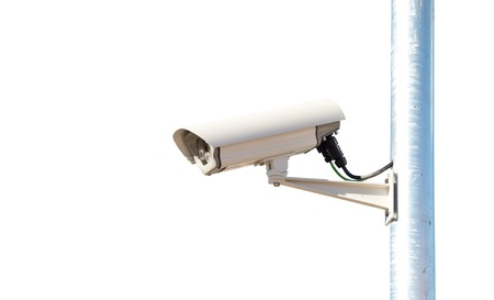 Security camera over white background