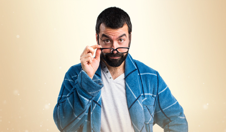 dressing gown: Man in dressing gown showing something Stock Photo