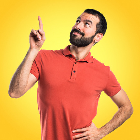 1 person: Handsome man pointing up Stock Photo