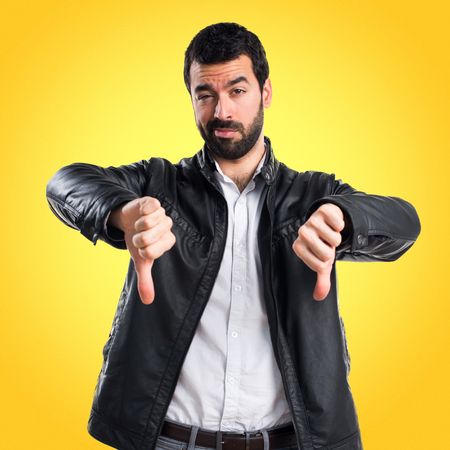 disapprove: Man with leather jacket doing bad signal Stock Photo