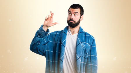 dressing gown: Man in dressing gown with his fingers crossing Stock Photo