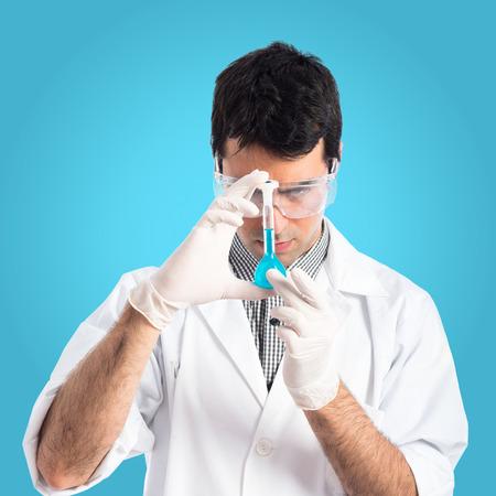 testtube: Scientist analyzing a test-tube