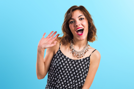 Pretty woman doing surprise gesture Stock Photo