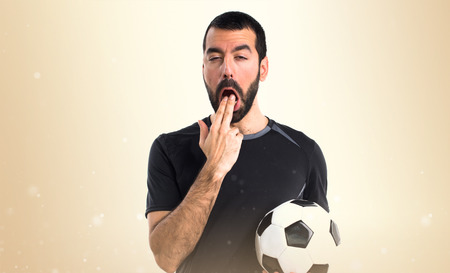 vomiting: Football player doing vomiting gesture Stock Photo