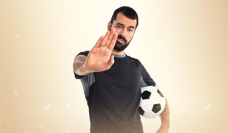 x sport: Football player doing NO gesture
