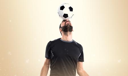 blonde hispanic: Man playing football