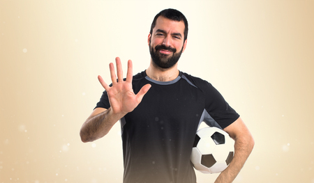 counting five: Football player counting five Stock Photo