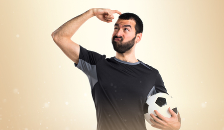 doubts: Football player having doubts Stock Photo