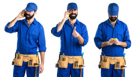 service man: Plumber talking to mobile Stock Photo