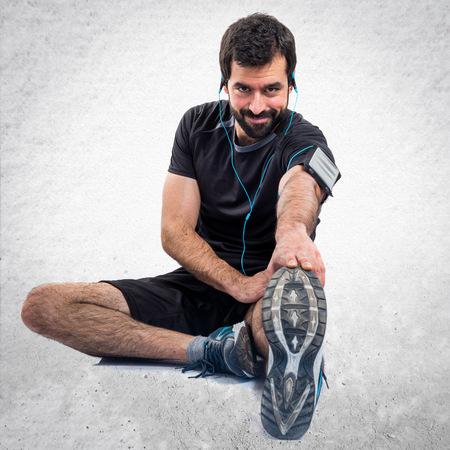 sportman: Sportman stretching Stock Photo