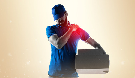hands work: Delivery man with shoulder pain Stock Photo