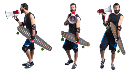 Skater shouting by megaphone Stock Photo
