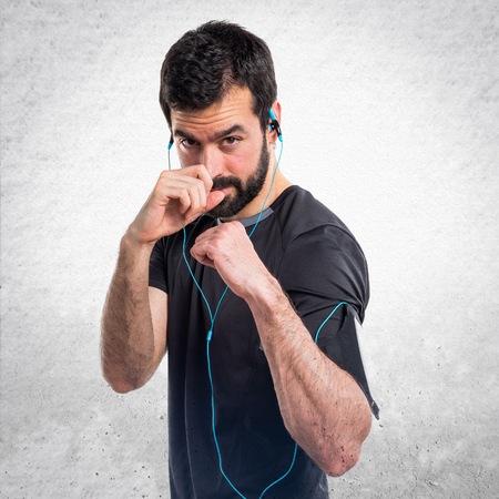 sportman: Sportman giving a punch Stock Photo