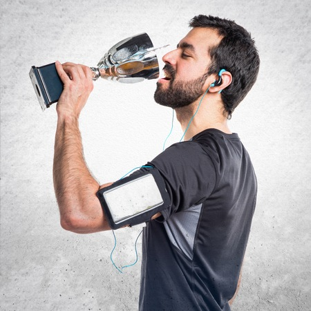 sportman: Sportman holding a trophy