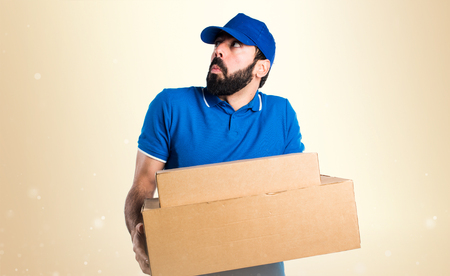 unimportant: Delivery man making unimportant gesture