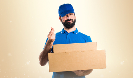 fragile economy: Delivery man doing a money gesture
