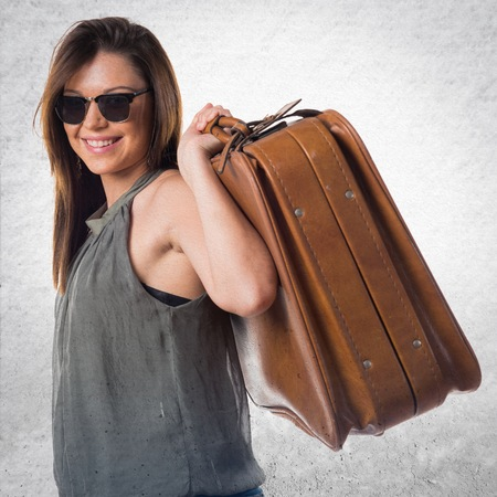 woman handle success: Young girl holding a briefcase Stock Photo