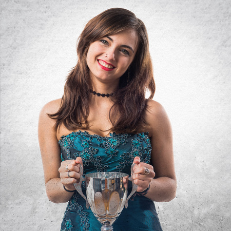 bridesmaid: Bridesmaid holding a trophy Stock Photo