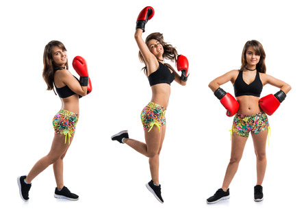 Young girl with boxing gloves Stock Photo