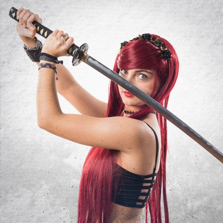 redhead girl: Young redhead girl with katana Stock Photo