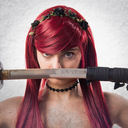 katana: Young redhead girl with katana Stock Photo