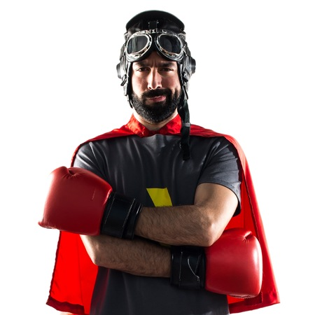 super cross: Superhero with boxing gloves with his arms crossed