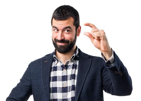 tiny: Handsome man doing tiny sign Stock Photo