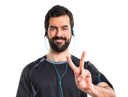 sportman: Sportman doing victory gesture