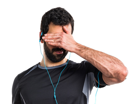 covering: Sportman covering his eyes Stock Photo
